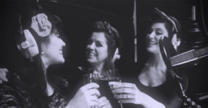 Vintage vocal swing singers enjoy a glass of champagne